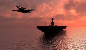 Silhouette of military aircraft carrier and military jet