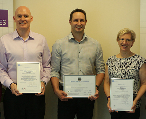 Nexor management team with the trio of certificates